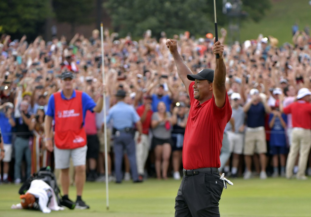 FILE - In this Sept. 23, 2018, file photo, Tiger Woods celebrates after on the 18th green after winning the Tour Championship golf tournament in Atlan...