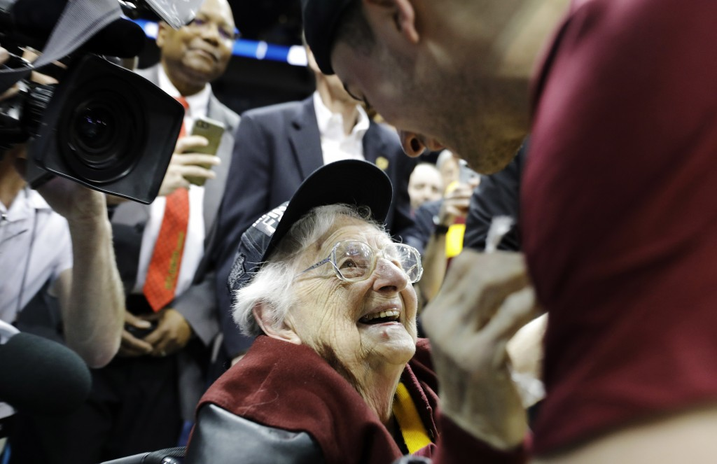 FILE - In this March 24, 2018, file photo, Loyola-Chicago basketball chaplain Sister Jean Dolores Schmidt speaks with Loyola-Chicago guard Ben Richard...