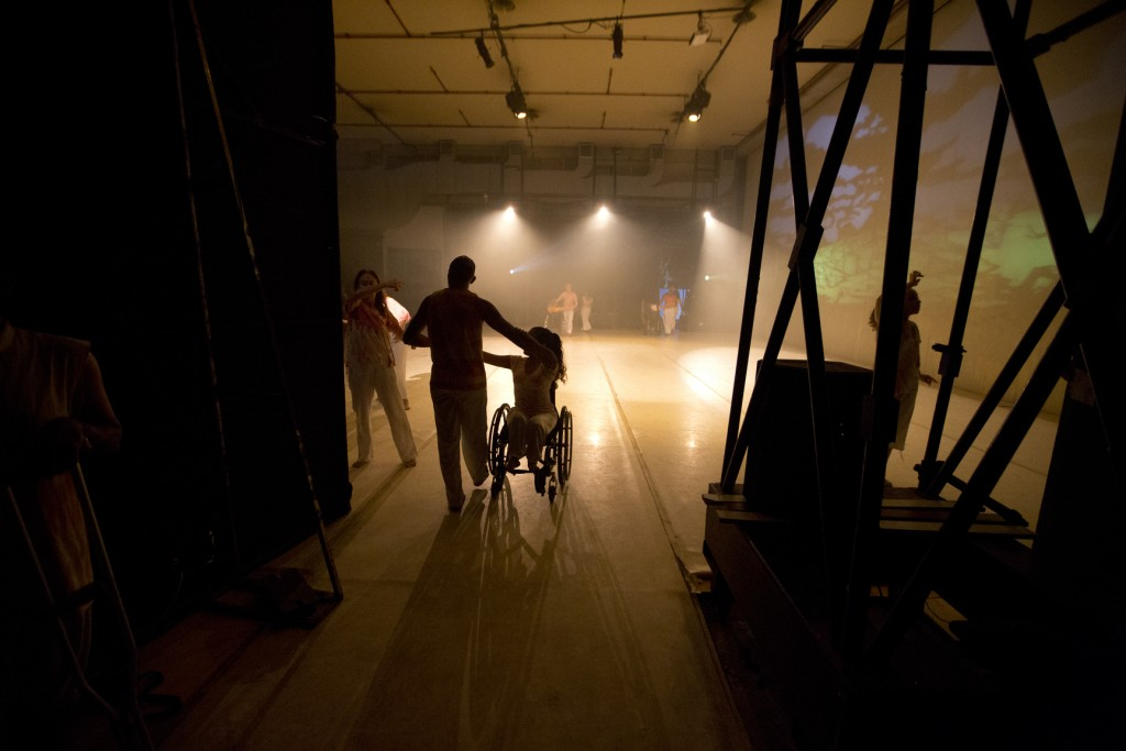 In this Dec. 4, 2018 photo, dancers take the stage to perform in the contemporary dance production Ubuntu, at the Teresa Carreno Theater in Caracas, V...