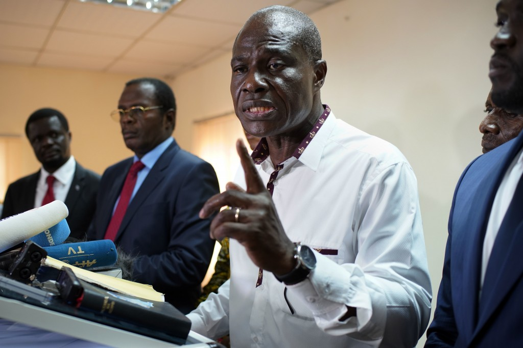 Congolese opposition presidential candidate Martin Fayulu and other opposition candidates address a news conference in Kinshasa, Congo, Tuesday Dec. 2...