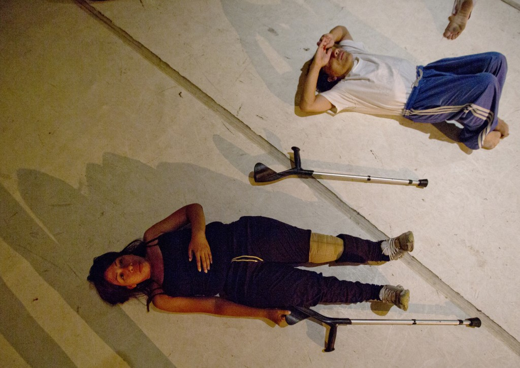In this Dec. 4, 2018 photo, dancers stretch prior to their performance in the contemporary dance production Ubuntu, at the Teresa Carreno Theater in C...