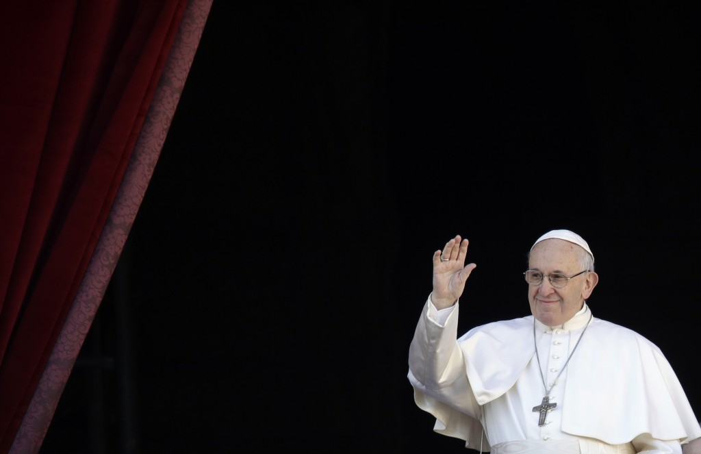 Pope Francis waves as he arrives to deliver the Urbi et Orbi (Latin for 'to the city and to the world' ) Christmas' day blessing from the main balcony...