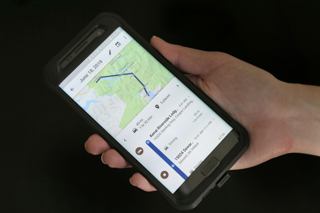 FILE - In this Aug. 8, 2018, file photo, a mobile phone displays a user's travels using Google Maps in New York. Google attracted concern about its co...