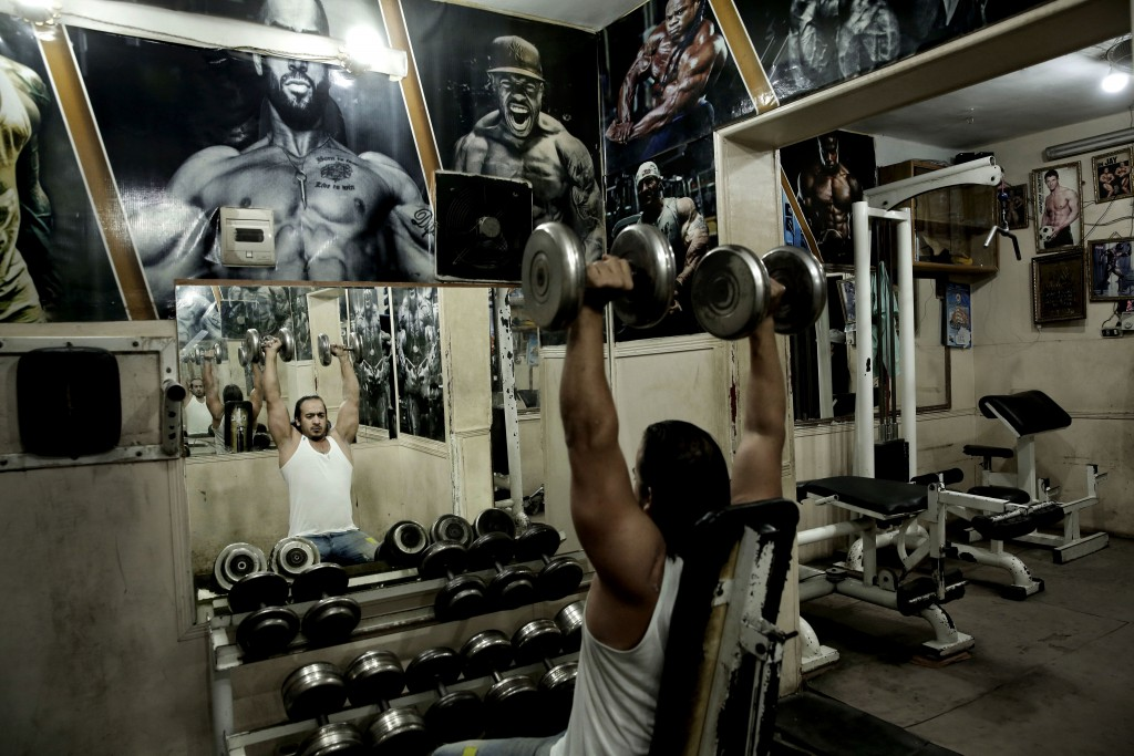 In this Oct. 23, 2018 photo, a man lifts barbells at a gym in the Shubra neighborhood of Cairo, Egypt. In televised comments in December 2018, Abdel-F...