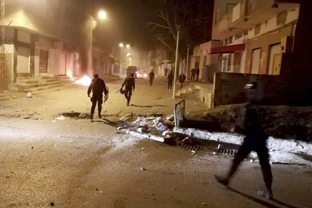 Tunisian Police officers patrol after clashes in the streets of Kasserine, southern of Tunisia, Tuesday, Dec 25, 2018.The death of a Tunisian journali...