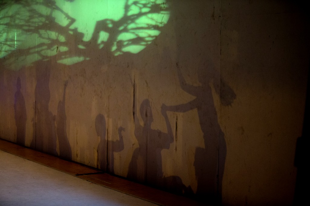 In this Dec. 4, 2018 photo, dancers' shadows are cast on a stage backdrop during the contemporary dance production Ubuntu, at the Teresa Carreno Theat...