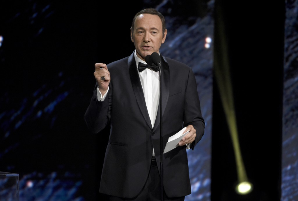 FILE - In this Oct. 27, 2017, file photo, Kevin Spacey presents an award in Beverly Hills, Calif. A Massachusetts prosecutor says Spacey is scheduled ...