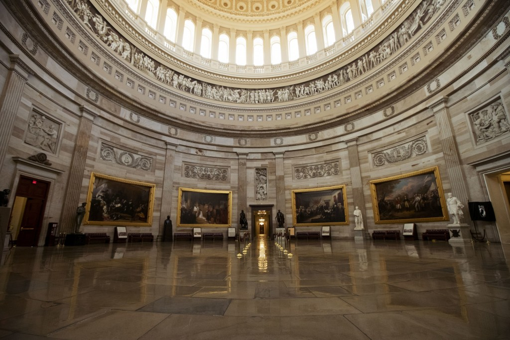 The empty U.S. Capitol Rotunda is seen during a partial government shutdown in Washington, Monday, Dec. 24, 2018. Both sides in the long-running fight...