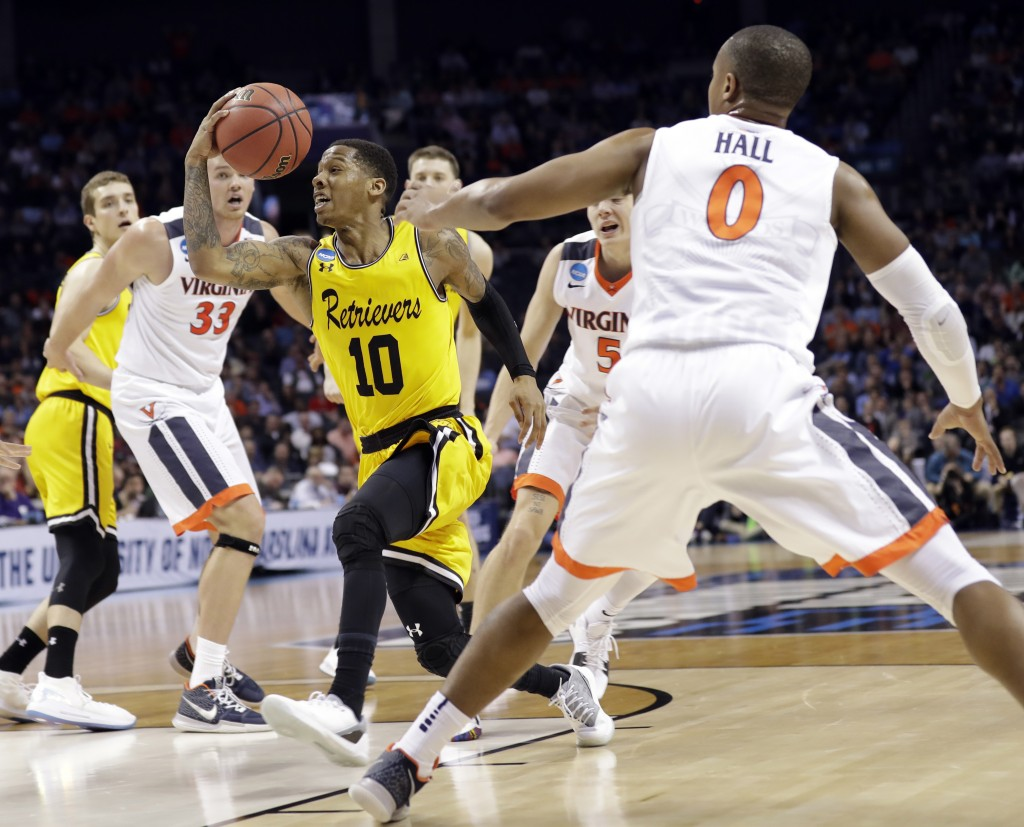 FILE - In this March 16, 2018, file photo, UMBC's Jairus Lyles (10) drives past Virginia's Devon Hall (0) during the second half of a first-round game...