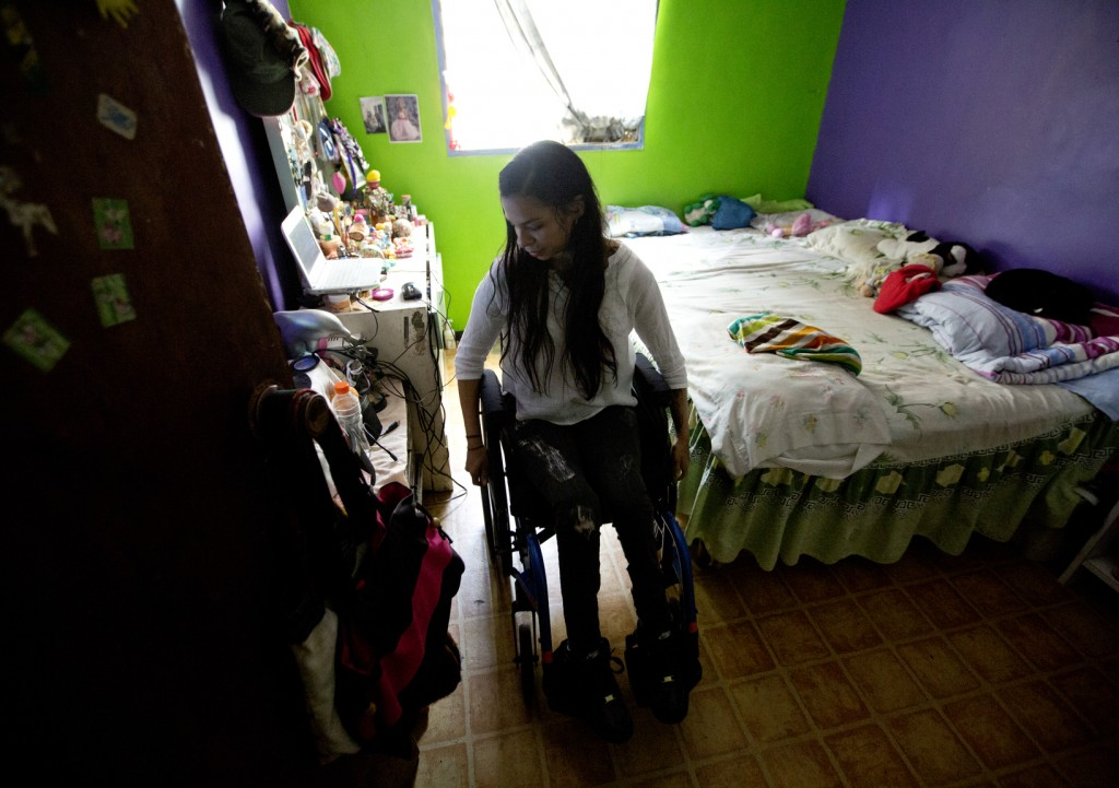 This Dec. 17, 2018 photo shows dancer Iraly Yanez in her home in Caracas, Venezuela. The ballerina was hit by a stray bullet on New Year's eve in 2010...