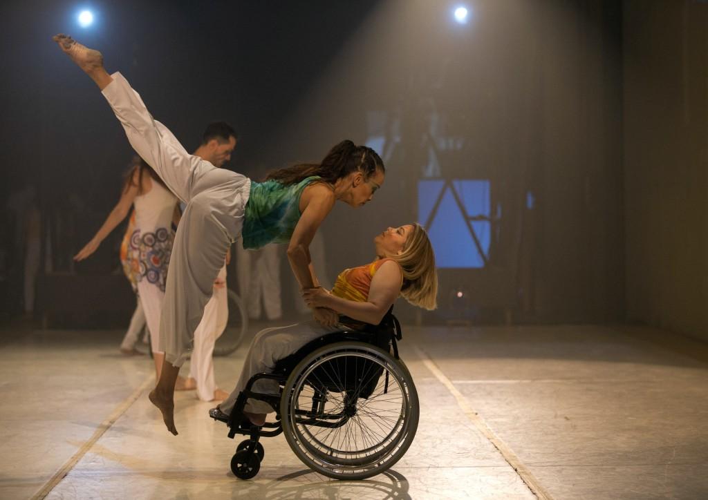 In this Dec. 4, 2018 photo, AM Danza dancers perform in the contemporary dance production Ubuntu, at the Teresa Carreno Theater in Caracas, Venezuela....