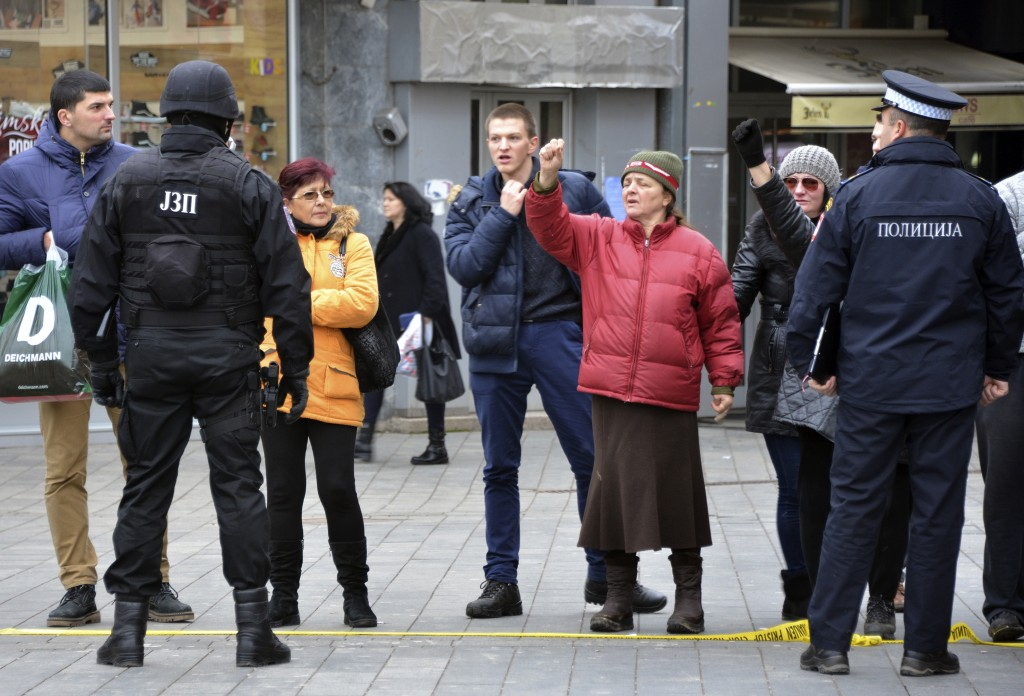 """Bosnian Serb police secure an area at the spot where Davor Dragicevic along with members of the """"Justice for David"""" movement protested and demanded th..."""
