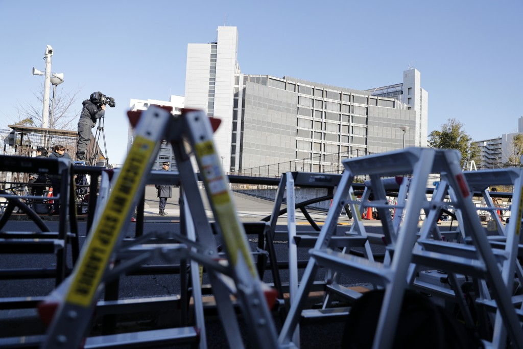 Step ladders of cameramen and photographers are placed in front of the gate of Tokyo Detention Center, where former Nissan chairman Carlos Ghosn and a...