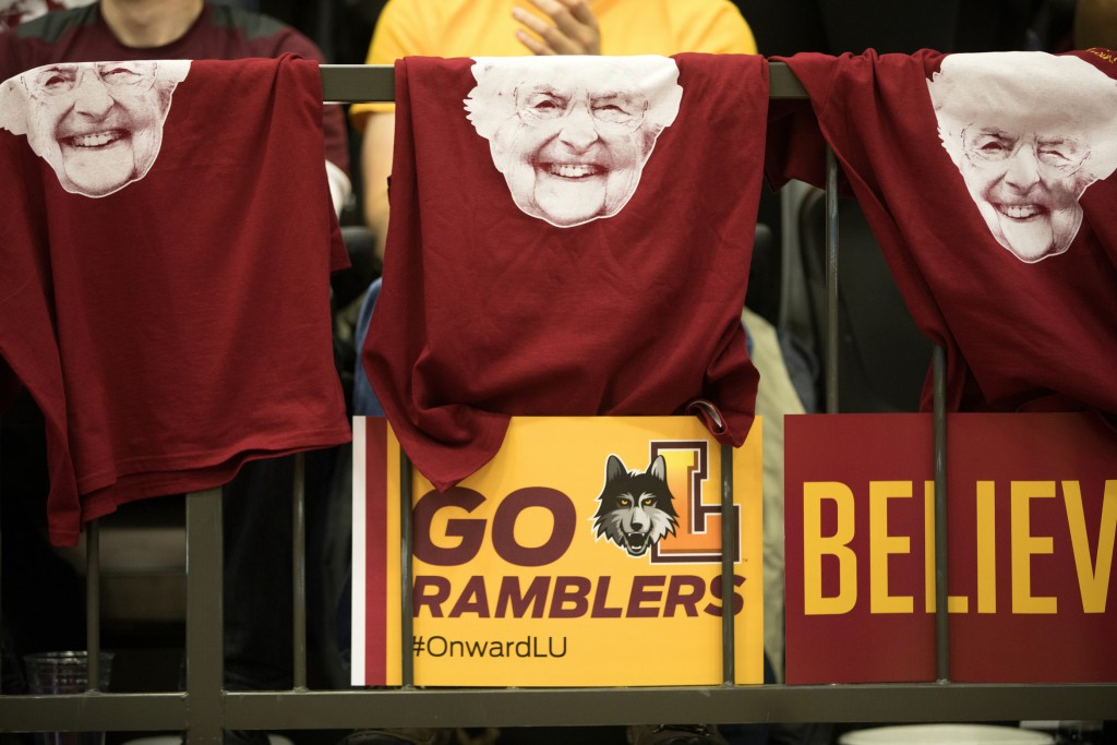 FILE - In this March 31, 2018, file photo, T-shirts with the face of Sister Jean Dolores Schmidt hang from a railing during the March Madness watch pa...