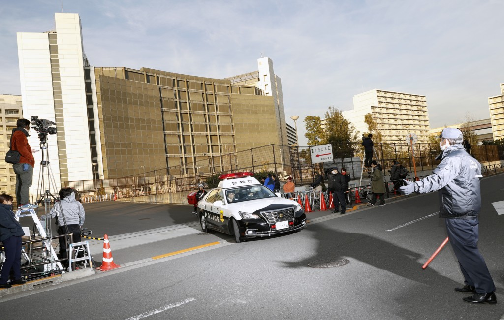 A police car drives away from Tokyo Detention Center, where former Nissan chairman Carlos Ghosn and another former executive Greg Kelly, are being det...