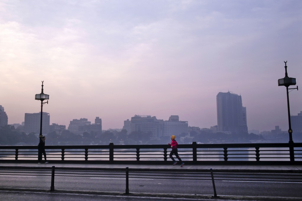 In this Jan. 22, 2017 file photo, a man jogs on Kasr El Nil bridge as the sun begins to rise, in Cairo, Egypt. In televised comments in December 2018,...