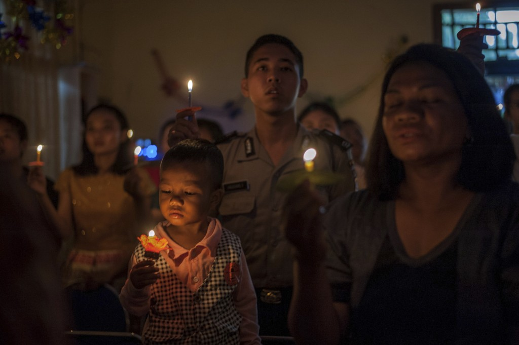People attend a Christmas service at Rahmat Pentecostal Church in Carita, Indonesia, Tuesday, Dec. 25, 2018. Christmas celebrations traditionally fill...