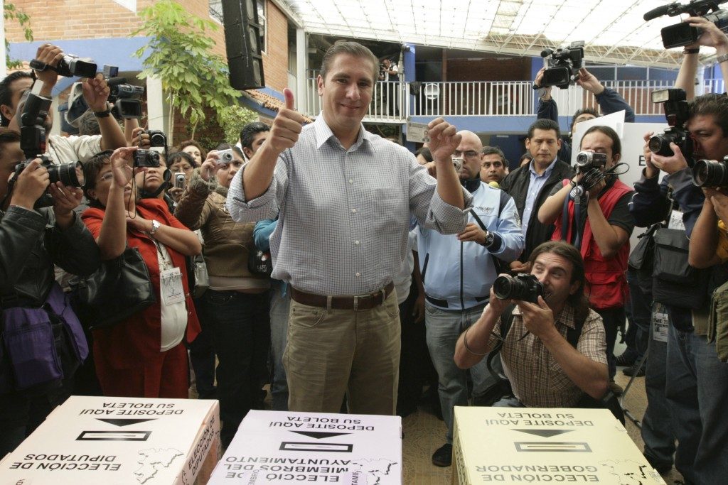 """FILE - In this July 4, 2010 file photo, Rafael Moreno Valle, candidate of the """"Compromiso por Puebla"""" party coalition, flashes two thumbs up after cas..."""