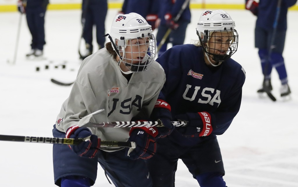 In a photo from, Thursday, Dec. 20, 2018, in Plymouth, Mich., USA Hockey forwards Hilary Knight, left, and Amanda Kessel skate during practice. After ...