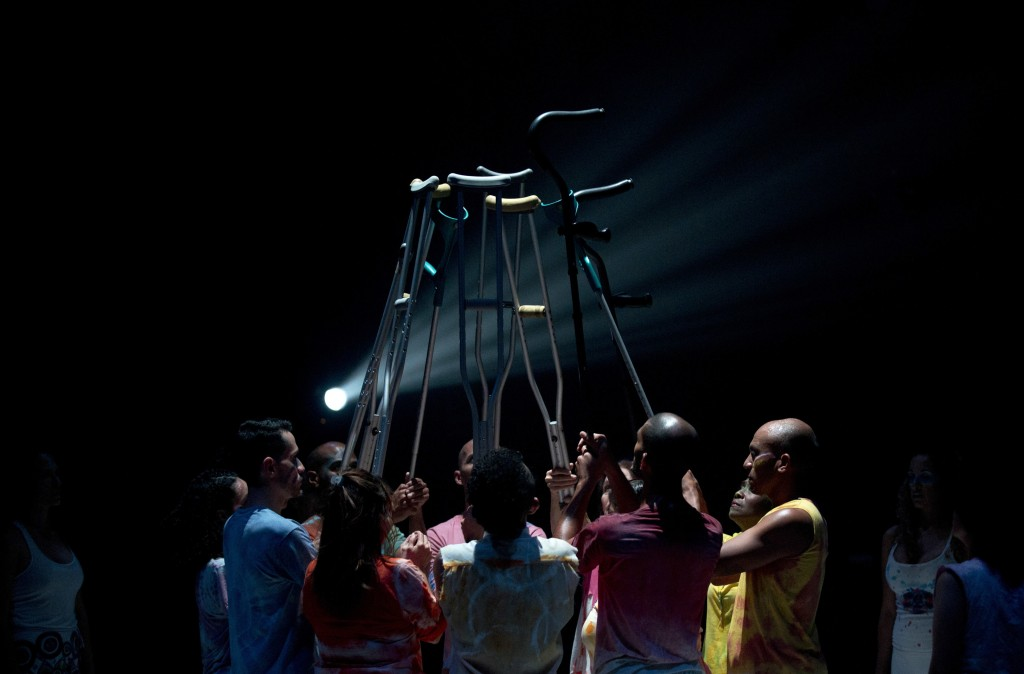 In this Dec. 4, 2018 photo, dancers hold canes and crutches in unison as they perform in the contemporary dance production Ubuntu, at the Teresa Carre...
