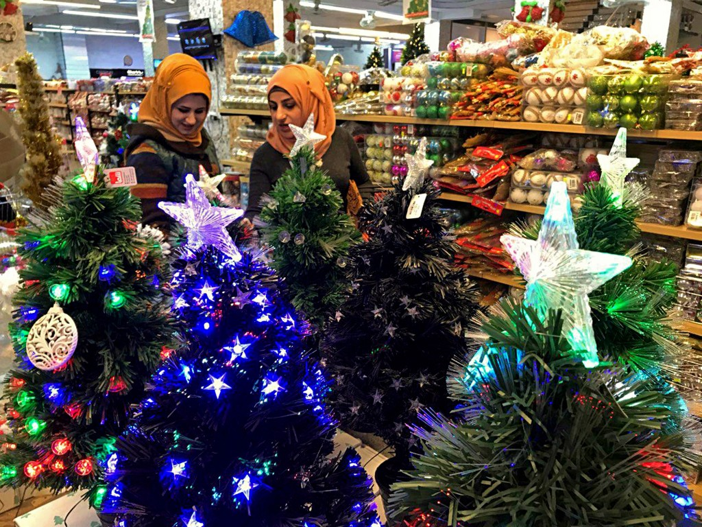 Iraqis shop for Christmas decorations in Baghdad, Iraq, Monday, Dec. 24, 2018. Although the number of Christians has dropped in Iraq, Christmas a nati...