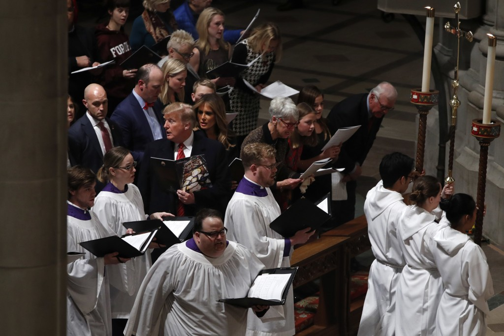 President Donald Trump and first lady Melania Trump attend a Christmas Eve service at the National Cathedral, Monday, Dec. 24, 2018, in Washington. (A...