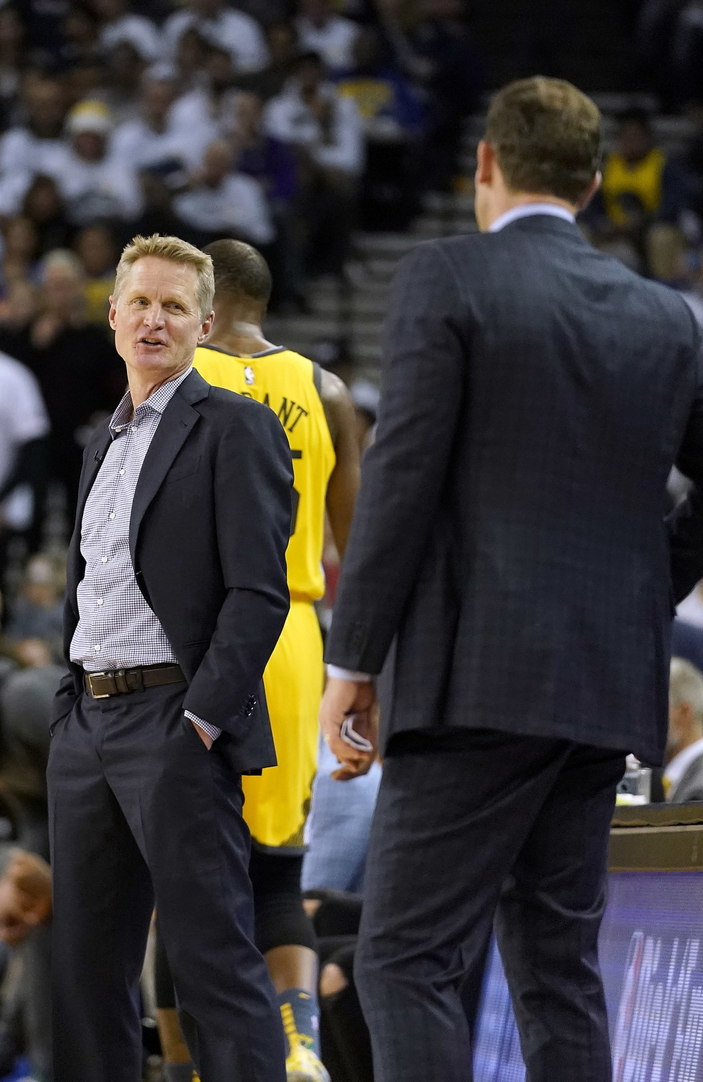 Golden State Warriors coach Steve Kerr, left, talks to Los Angeles Lakers coach Luke Walton during a timeout on the first half of an NBA basketball ga...