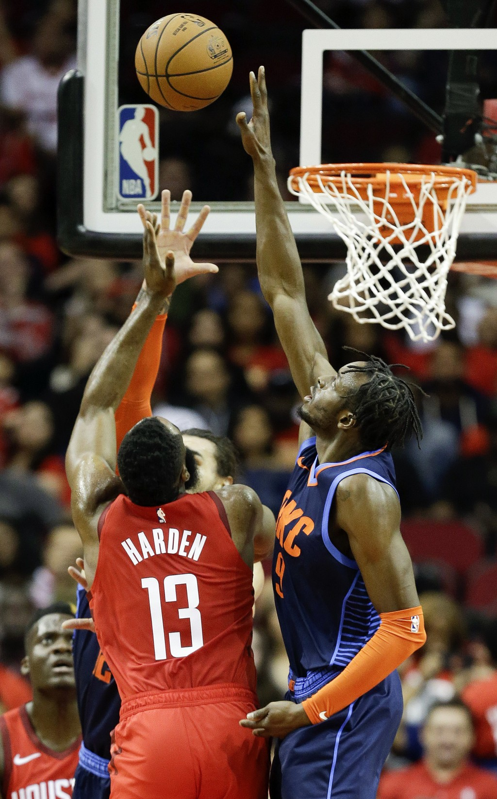 Oklahoma City Thunder forward Jerami Grant, right, blocks the shot of Houston Rockets guard James Harden (13) during the first half of an NBA basketba...