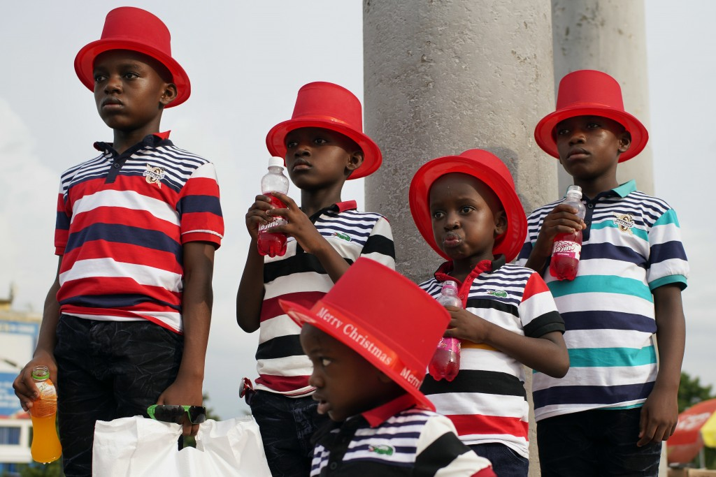 Children pose for a photograph in Kinshasa, Congo, Tuesday Dec. 25, 2018. Traditionally Congolese dress up and take to the parks on Christmas day, thi...