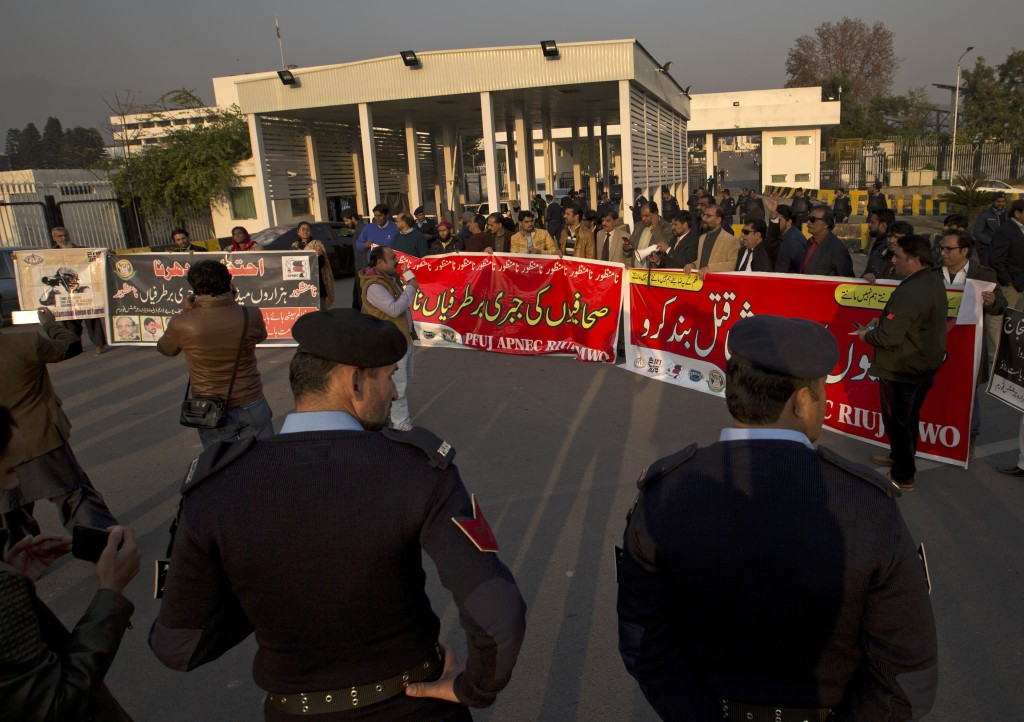 In this Thursday Dec. 20, 2018 photo, jobless newspaper workers protest near the Parliament, in Islamabad, Pakistan. Pakistan's military and security ...