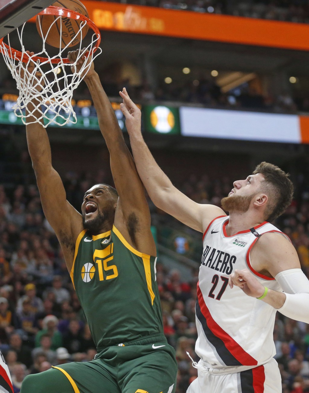 Utah Jazz forward Derrick Favors (15) goes to the basket as Portland Trail Blazers center Jusuf Nurkic (27) defends during the first half of an NBA ba