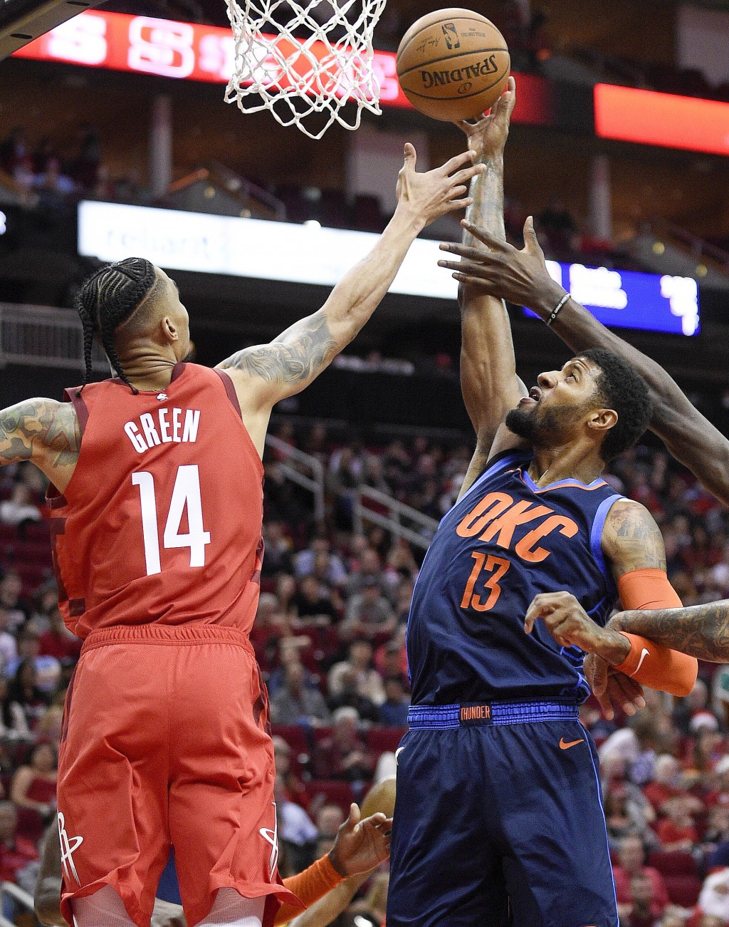 Oklahoma City Thunder forward Paul George, right, grabs a rebound away from from Houston Rockets guard Gerald Green, left, during the first half of an...