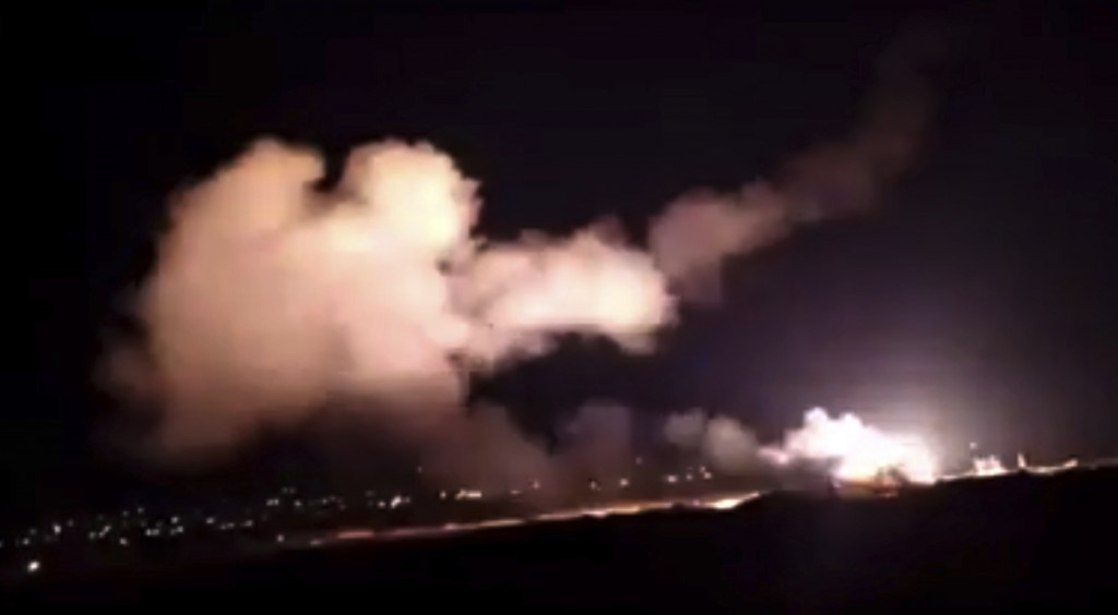 This frame grab from a video provided by the Syrian official news agency SANA shows missiles flying into the sky near Damascus, Syria, Tuesday, Dec. 2...