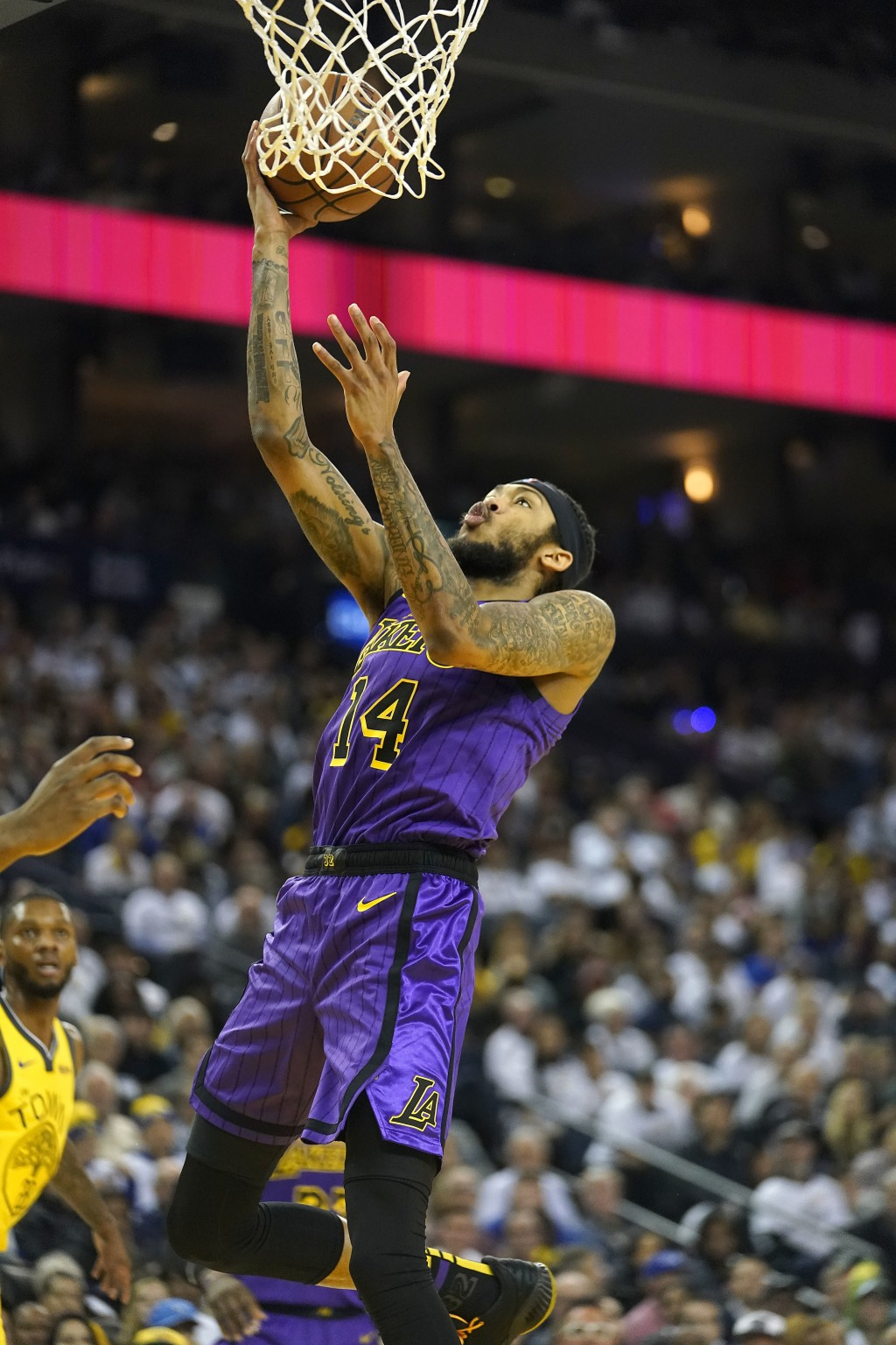 Los Angeles Lakers forward Brandon Ingram (14) drives to the basket against the Golden State Warriors during the first half of an NBA basketball game ...