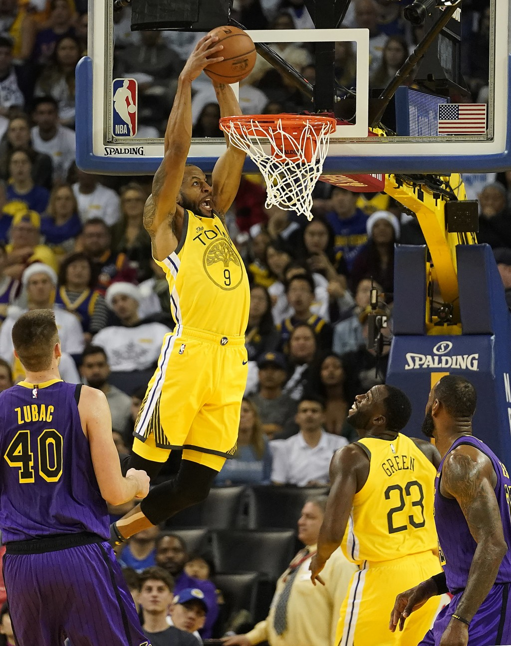Golden State Warriors guard Andre Iguodala (9) dunks in front of Los Angeles Lakers center Ivica Zubac (40) during the first half of an NBA basketball
