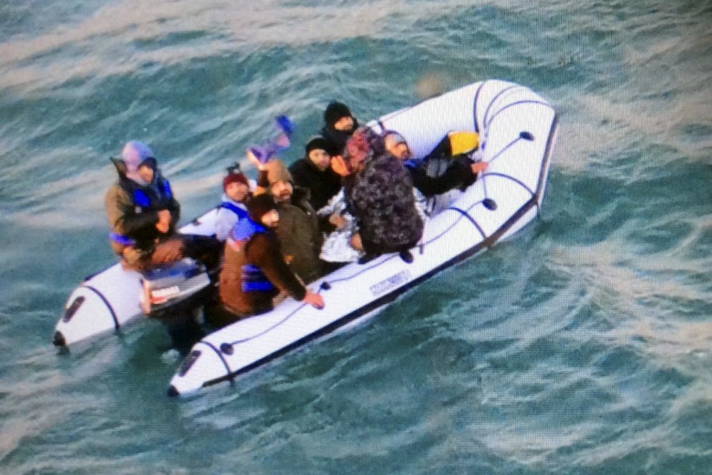 This image provided by the Marine Nationale (French Navy) shows migrants aboard a rubber boat after being intercepted by French authorities, off the p...