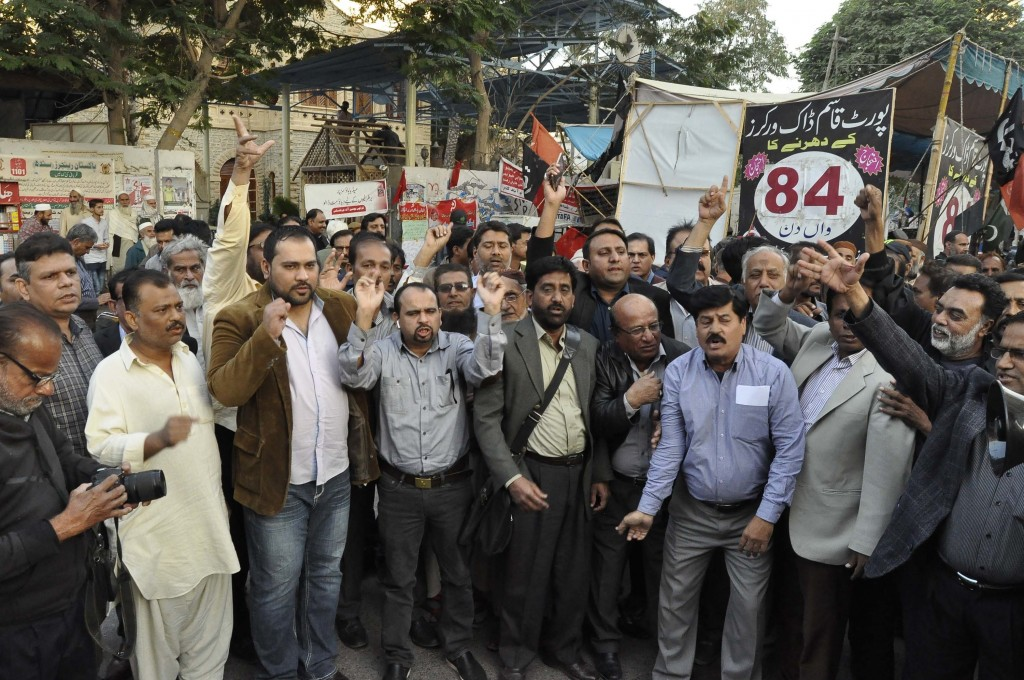 In this Monday, Dec. 17, 2018 photo, Pakistani journalists protest against recent layoffs of newspaper workers, outside a press club in Karachi, Pakis...