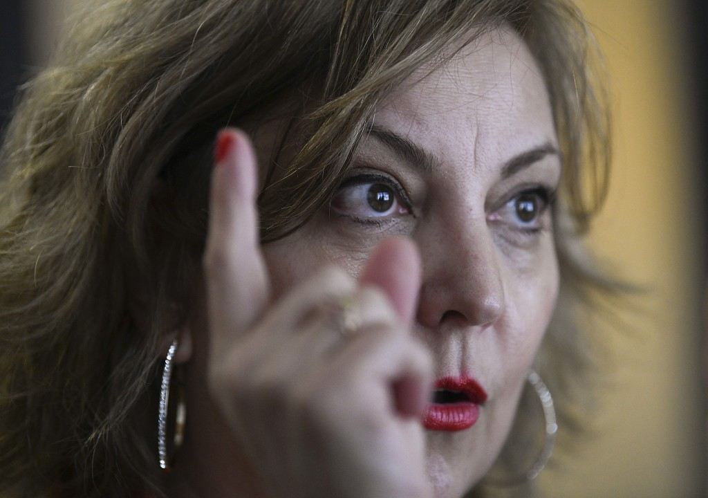 In this Dec. 19, 2018 photo, congressional aide Claudia Guebel speaks during an interview, in Buenos Aires, Argentina. At the beginning of this year,