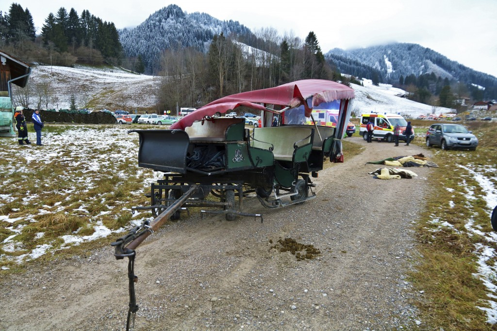 A damaged carriage sits on a path near Pfronten, southern Germany, Tuesday, Dec. 25, 2018. 20 people were injured, two of them seriously, when two hor...