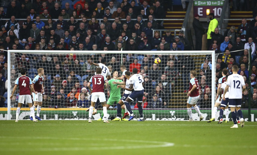 Everton's Yerry Mina scores his side's first goal of the game during the English Premier League soccer match between Burnley and Everton at Turf Moor,