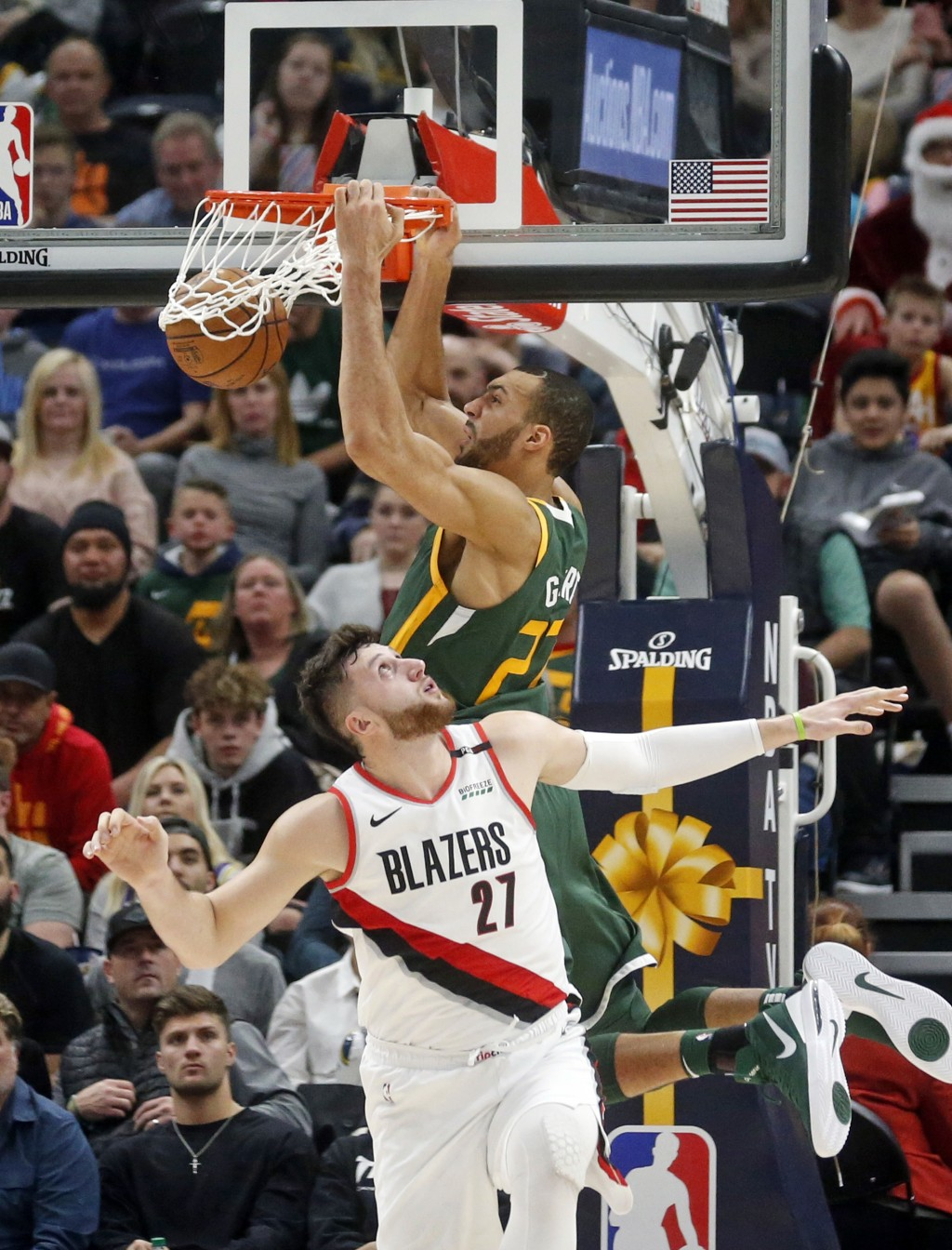 Utah Jazz center Rudy Gobert, rear, dunks on Portland Trail Blazers center Jusuf Nurkic (27) during the second half of an NBA basketball game Tuesday,...