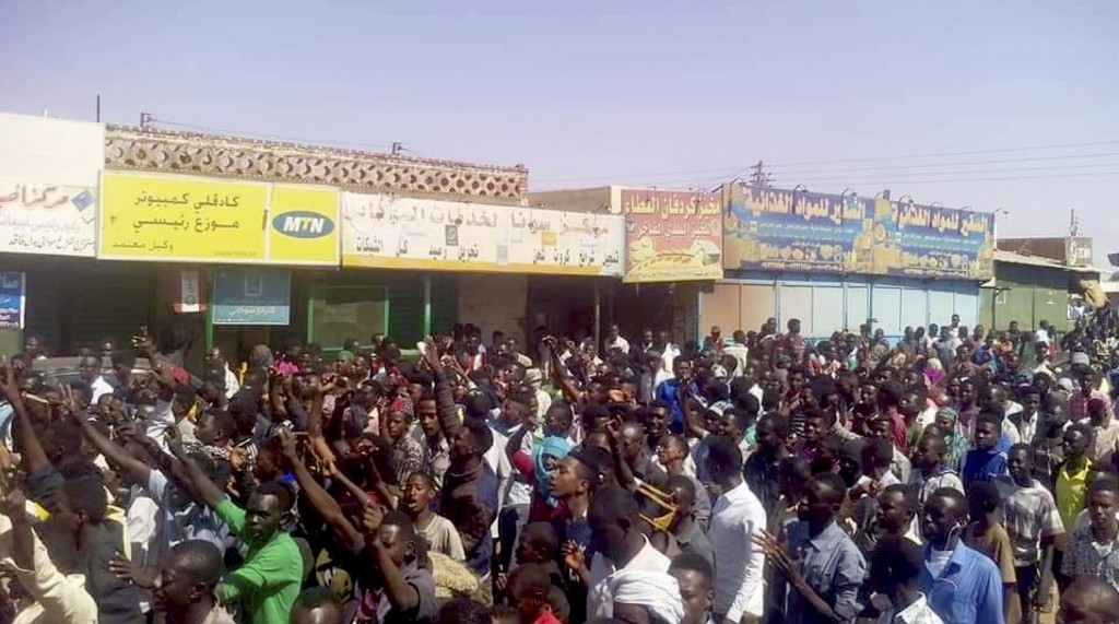 In this Tuesday, Dec. 25, 2018 handout image provided a Sudanese activist, people chant slogans during a demonstration in Kordofan, Sudan. In the capi...