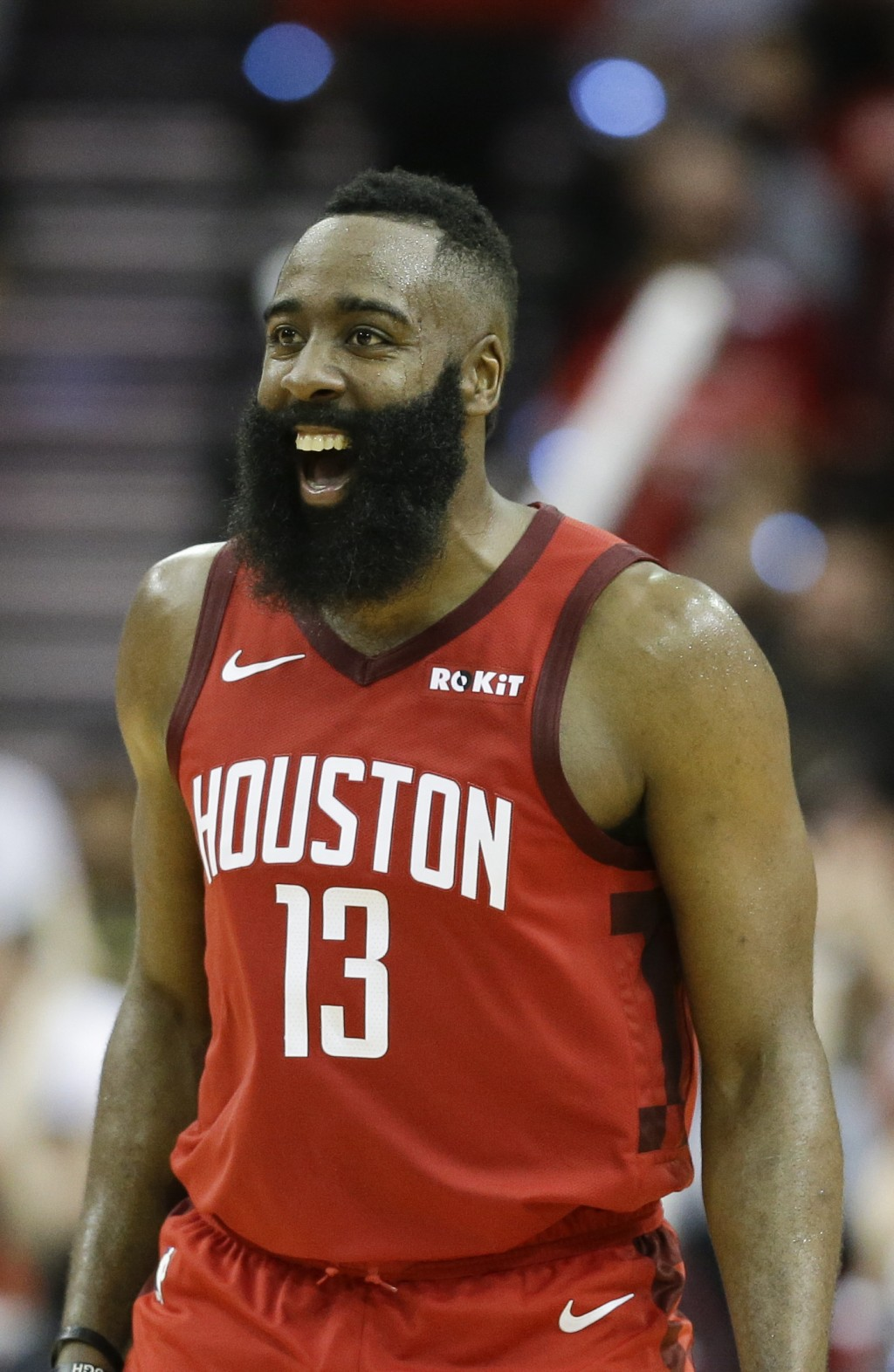Houston Rockets guard James Harden reacts after guard Austin Rivers' three-point basket late in the second half of an NBA basketball game against the ...