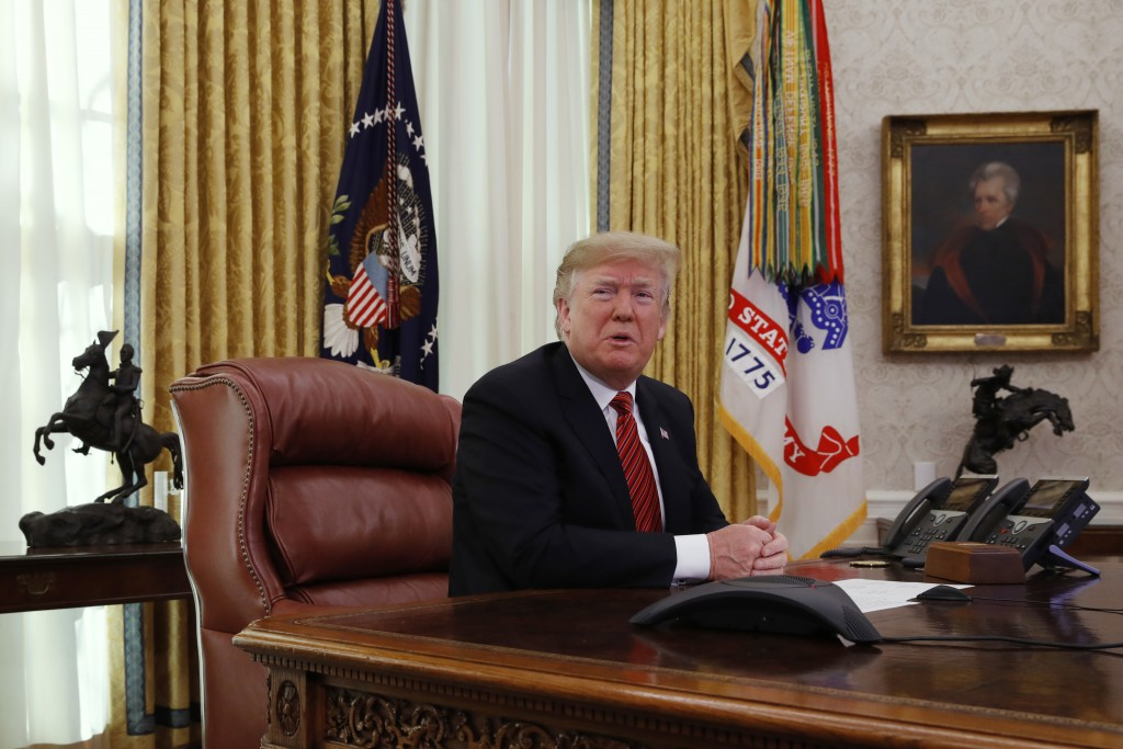 President Donald Trump answers questions from the media after speaking with members of the military by video conference on Christmas Day, Tuesday, Dec...