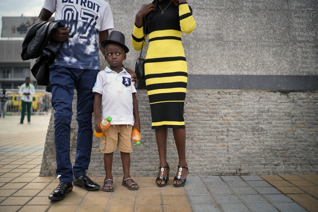 A Congolese family pose for a photograph in Kinshasa , Congo, Tuesday Dec. 25, 2018. Traditionally Congolese dress up and take to the parks on Christm...
