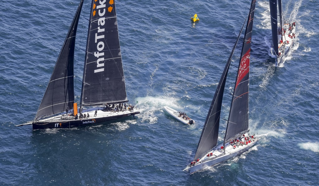 In this photo provided by Rolex/Studio Borlenghi, maxi yachts Infotrack, left, Wild Oats XI and Scallywag, right, battle for position after the start ...