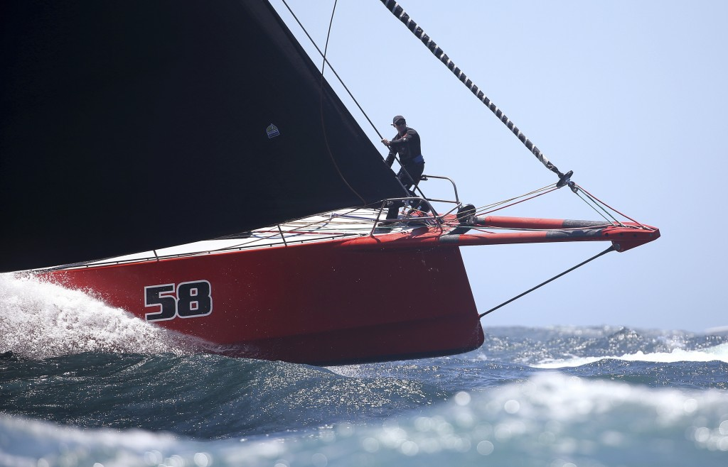 The bowman of Comanche directs his helmsman during the start of the Sydney Hobart yacht race in Sydney, Wednesday, Dec. 26, 2018. The 630-nautical mil