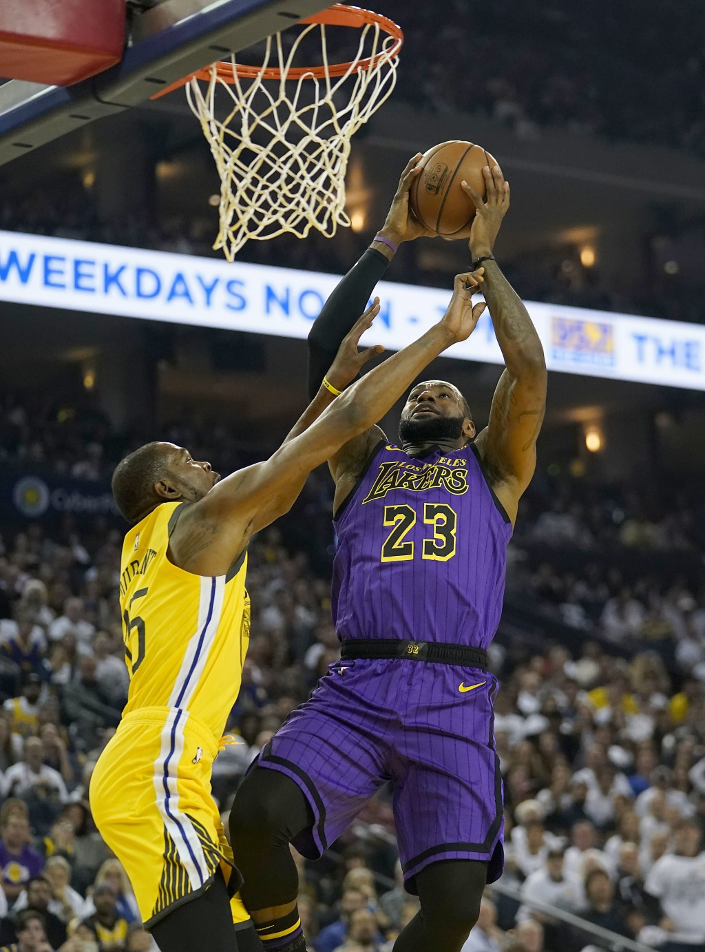 Los Angeles Lakers forward LeBron James (23) shoots over Golden State Warriors forward Kevin Durant (35) during the first half of an NBA basketball ga...