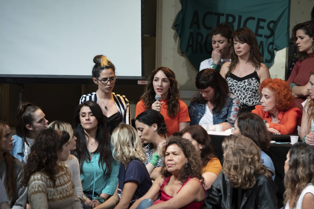 FILE - In this Dec. 11, 2018 file photo, accompanied by members of Argentine Actresses, Thelma Fardin speaks during a press conference where she accus