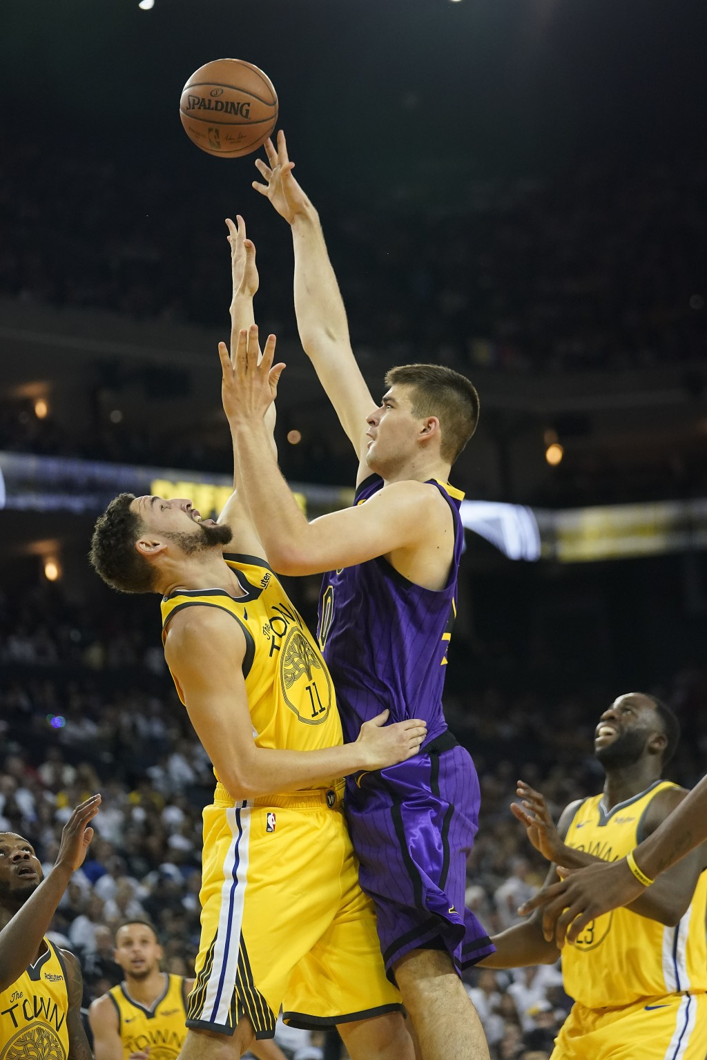 Los Angeles Lakers center Ivica Zubac (40) shoots over Golden State Warriors guard Klay Thompson (11) during the first half of an NBA basketball game